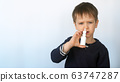 Child boy spraying medicine in nose against flu. Self-medicating, nose spray, health and care concept. 63747287