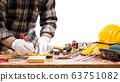 Carpenter at work on wooden boards. Carpentry. 63751082