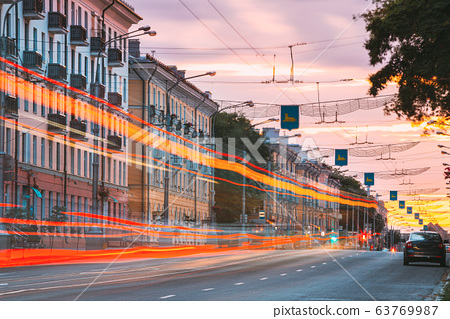Gomel, Belarus. Traffic And Light Trails On Lenin Avenue In Eveining Or NIght. Street At Night At Long Exposure 63769987