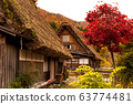 The Village of Shirakawa, a world heritage site, with its traditional houses with gassho-zukuri-style roofs at daylight in autumn 63774481