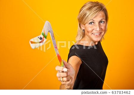 Scandinavian woman with boomerangs 63783462