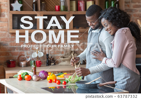 Reduce spread of coronavirus. Collage with African American couple cooking in kitchen and text STAY HOME 63787332