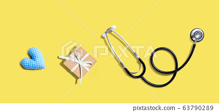 Stethoscope with a gift and a heart cushion 63790289