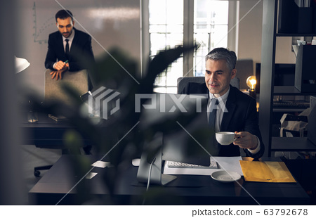 Mature office worker in suit working at computer 63792678