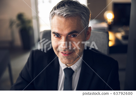 Mature office worker in suit looking at camera 63792680