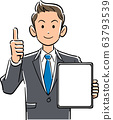 Businessman holding a tablet PC with a blank screen and thumbs up 63793539