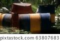Rusty barrels in green forest 63807683
