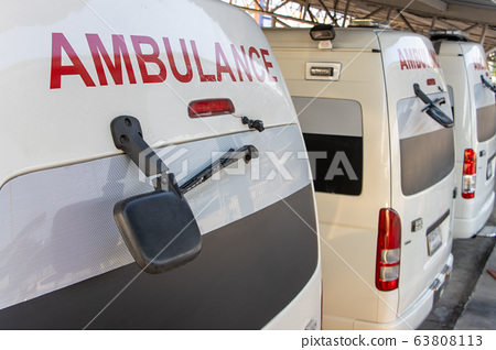 Back of ambulances standing in parking lot of 63808113