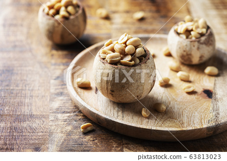 Salt peanut on the wooden table 63813023