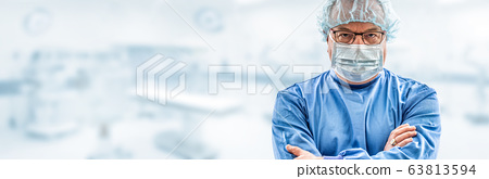 Doctor surgeon specialist looks concentrating. In 63813594