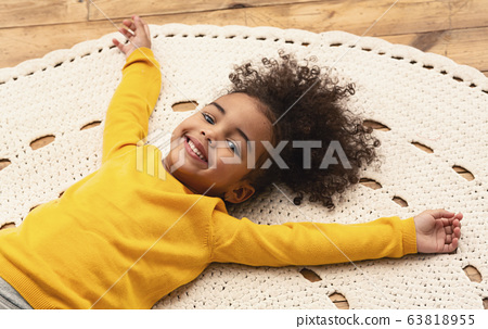 African american little girl on carpet, stay at home 63818955