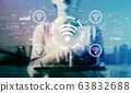 Wifi theme with businesswoman using a tablet 63832688