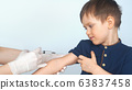 vaccination of a child syringe, vaccine little boy. Doctor give injection to boy's arm 63837458