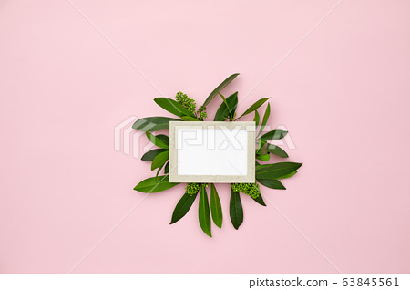 photo frame decorated with green leaves 63845561