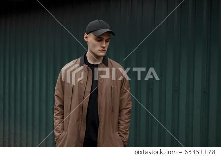Handsome model man in a fashion vintage coat  63851178