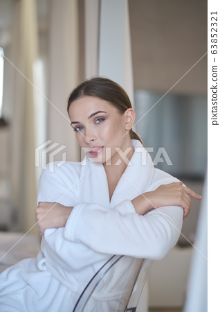 woman resting in a bathrobe at home 63852321