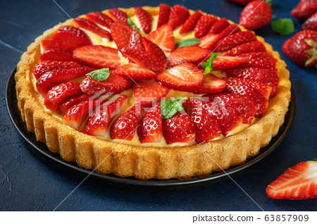 Close up of delicious strawberry flan on dark blue 63857909