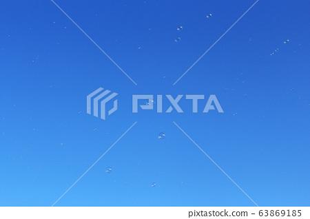 Bubbles in blue sky 63869185