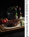 Meat steak on a wooden board. catering menu 63890075