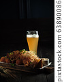 Glass of cold beer with appetizer. catering menu 63890086