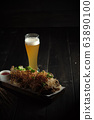 Glass of cold beer with appetizer. catering menu 63890100