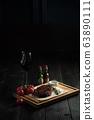 Meat steak on a wooden board. catering menu 63890111