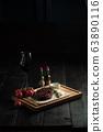 Meat steak on a wooden board. catering menu 63890116