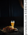 Glass of cold beer with appetizer. catering menu 63890120