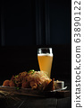Glass of cold beer with appetizer. catering menu 63890122