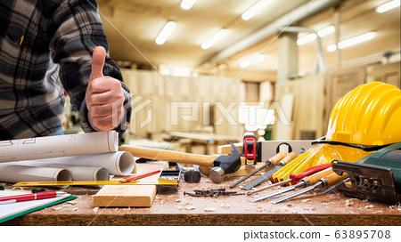 Carpenter at work in the carpentry workshop. 63895708