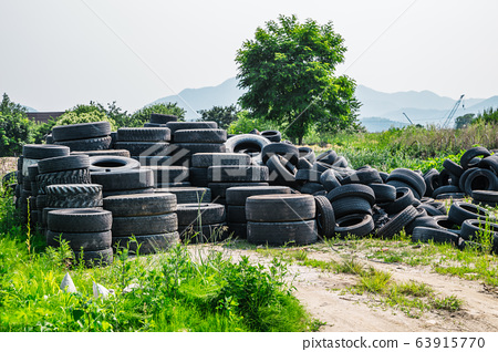 Piles of waste rubber tire 63915770