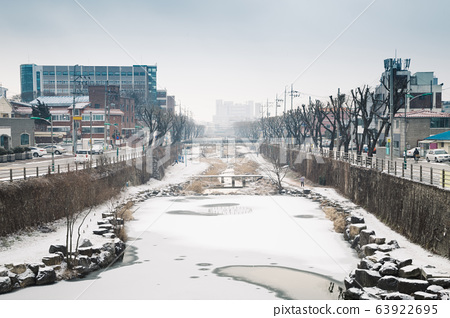 Snow covered town and river at winter in Suwon, Korea 63922695