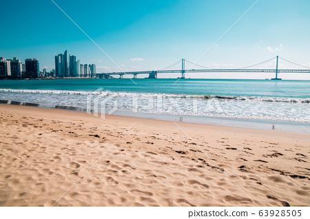 Gwangan bridge with beach in Busan, Korea 63928505