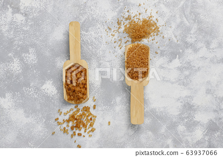 Various types of brown sugar on concrete background,top view 63937066