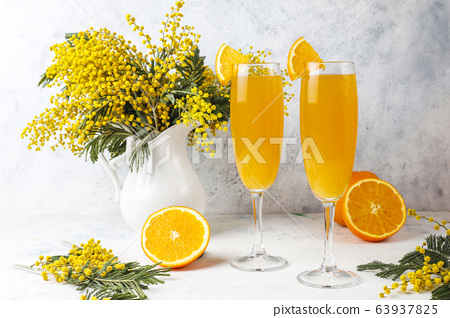 Homemade Refreshing Orange Mimosa Cocktails with Champaigne 63937825