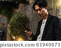 Young man (beer, night, drinking out, outdoor 63940073