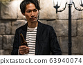Young man (beer, night, drinking out, outdoor 63940074