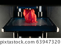 3d printer prints the model of heart, process of printing organs on a 3d printer, creating a model of the human heart. 63947320