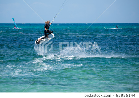 The kite surfer rides the waves of the Atlantic Ocean 63956144