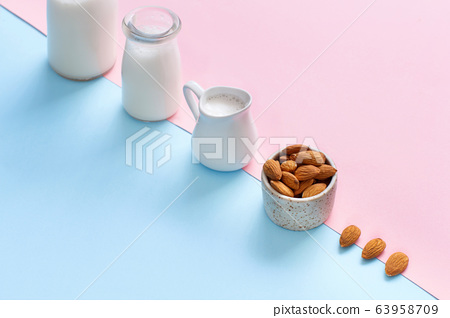 Vegan almond milk on a pink and blue background 63958709