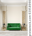 Art deco style beige interior with green sofa, columns, table lamp, moldings. 63958990