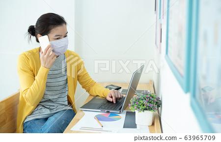 Asian beautiful women wearing masks work at home, 63965709