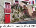 Amazing narrow streets of Mykonos island. Sunny 63994199