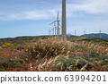 Windmill power stations on windy hill and 63994201