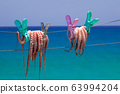 Fresh octopus drying on the rope, Crete island, 63994204