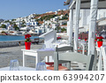 Outdoor restaurant with sea view. Greece vacation 63994207