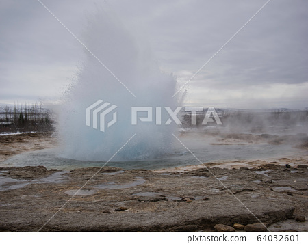 A large water fountain from the geyser in Iceland 64032601