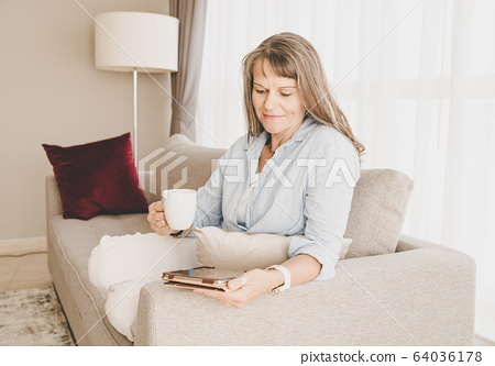 Woman with a tablet 64036178