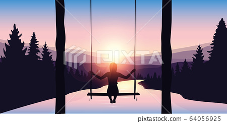 girl on a swing at beautiful big river in a forest at sunrise purple landscape 64056925