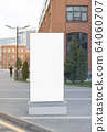 Blank white vertical pylon stand mock up brick building background 64060707